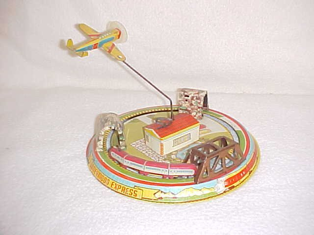 1: Tin litho wind up Honeymoon Express toy by Marx