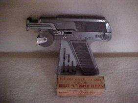 11: JMCO super-numatic cap gun w/Buddy L paper refills