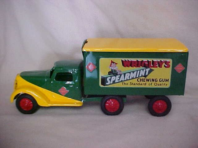 64: Dunwell certified metal toy truck and trailer