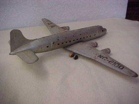 14: Early tin litho airplane