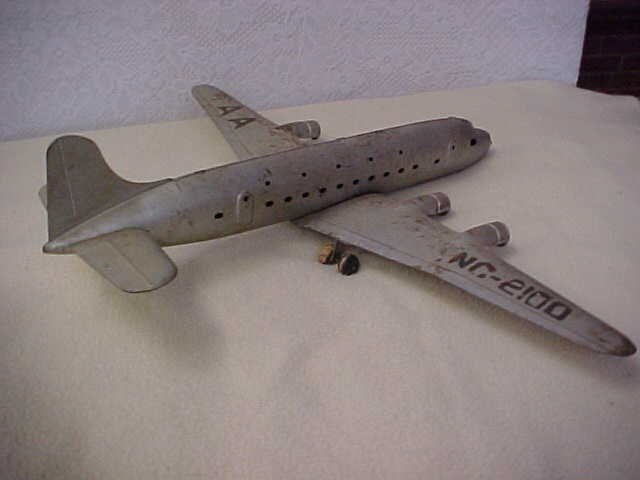 14: Early tin litho airplane