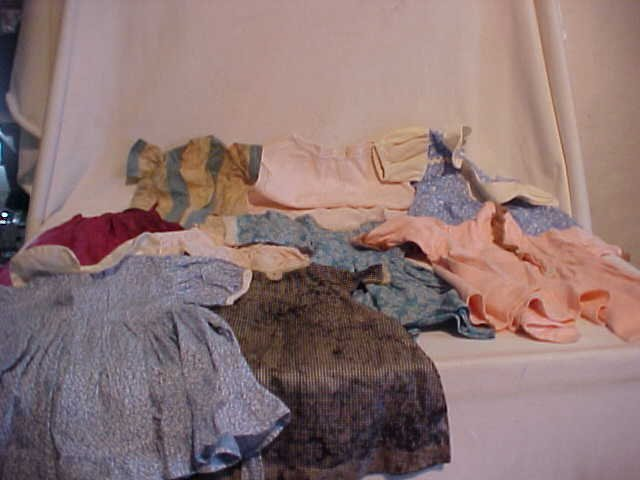 6: Lot of 10 doll clothes/outfits