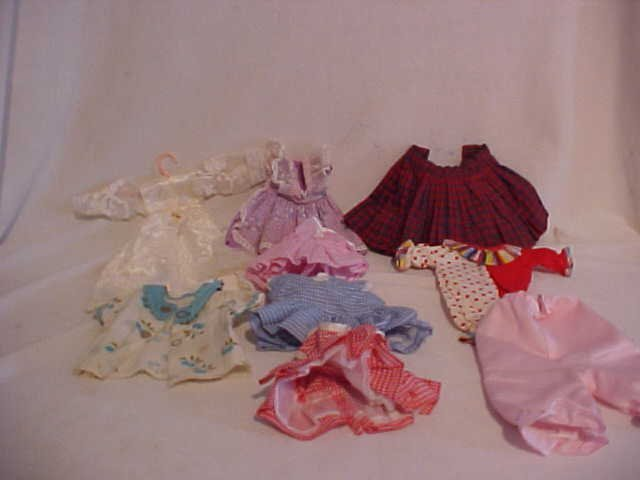 7: Lot of 10 doll clothes/outfits
