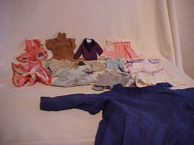 8: Lot of 10 doll clothes/outfits