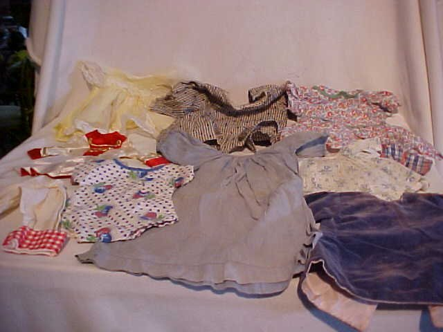 9: Lot of 10 doll clothes/outfits