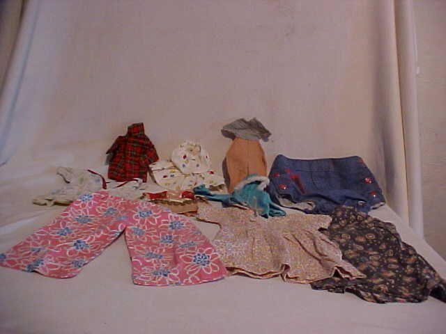15: Lot of 10 doll clothes/outfits