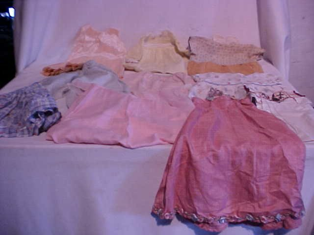 17: Lot of 10 doll clothes/outfits