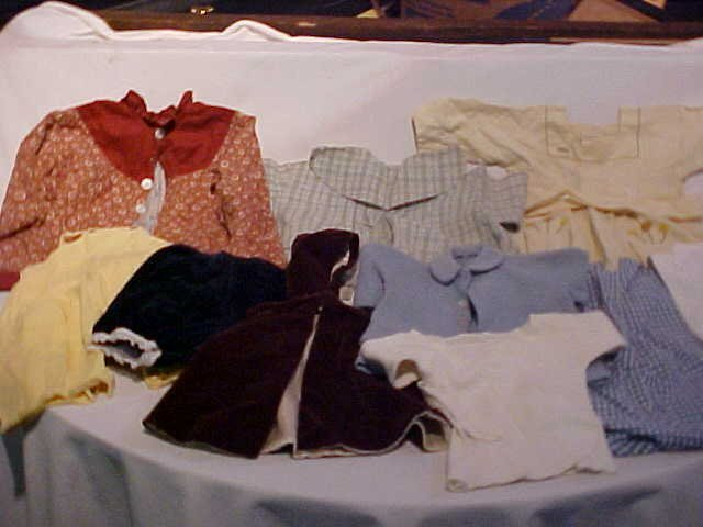 19: Lot of 10 doll clothes/outfits