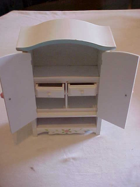 14: Doll house size wardrobe with music box