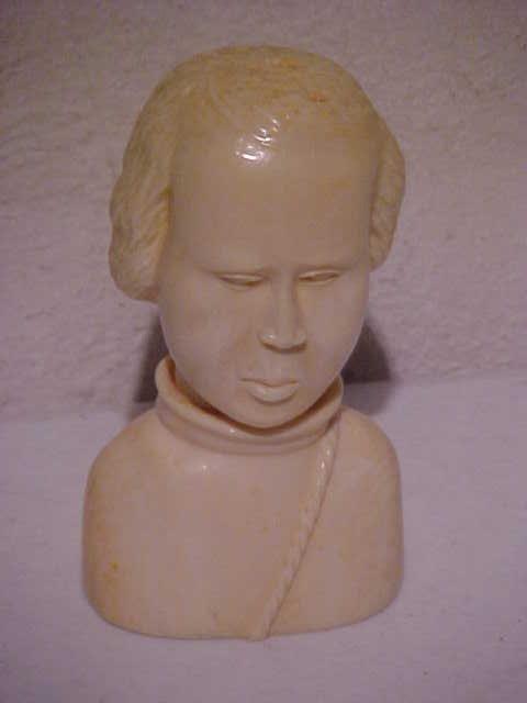 10: Small ivory bust signed Asimbo