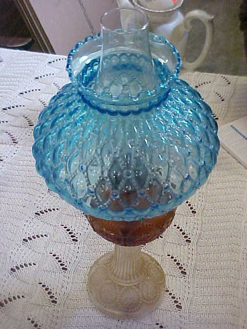 2002: Vintage oil lamp w/blue quilted shade.