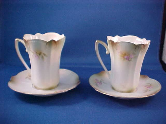 2009: Pair R.S. Prussia floral decorated cup & saucers.