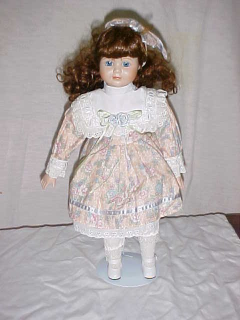 "3013: Porcelain Doll 17""tall."