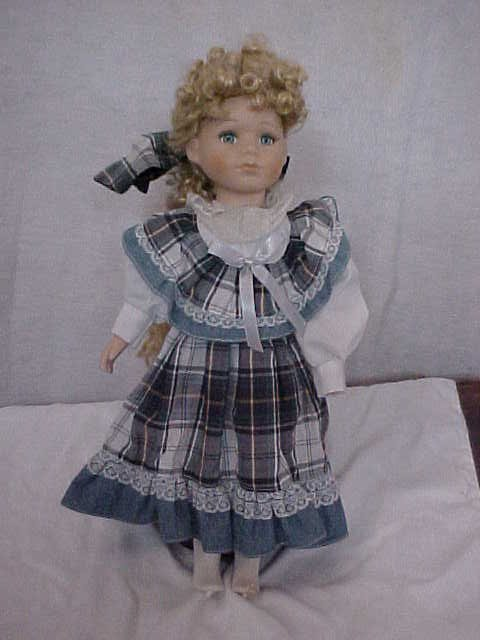 "3014: Porcelain Doll 15-1/2""tall."