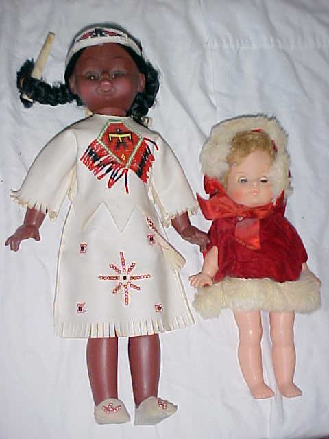3018: Lot of 2 plastic  dolls Native American & Christm