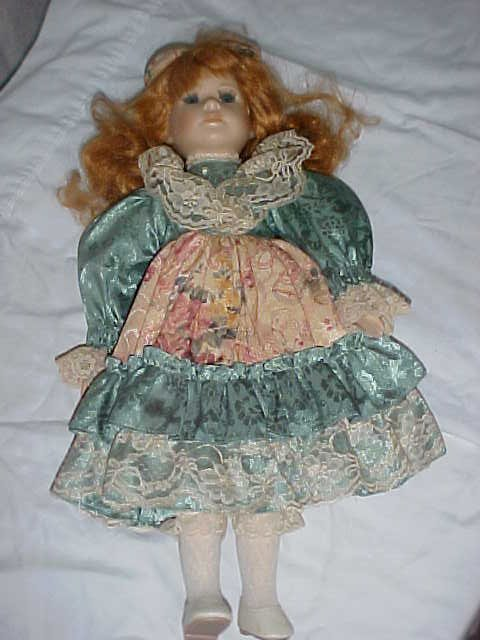 "3020: Porcelain doll w/Initial ""A"" on back of neck 17-1"