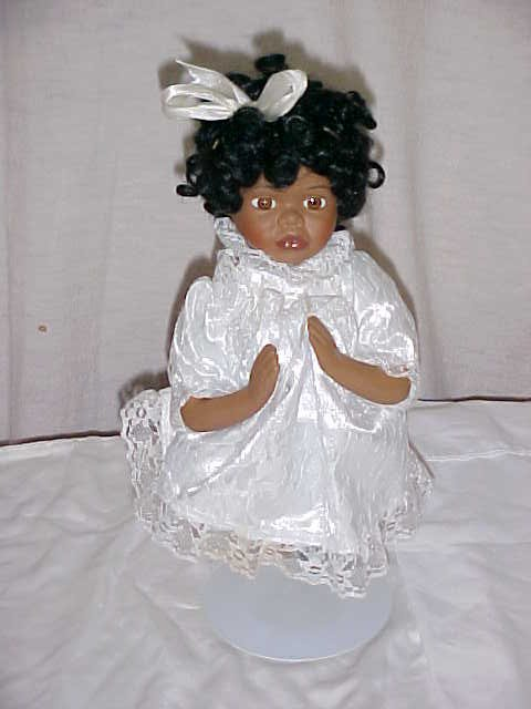 3026: African American porcelain doll by Crown fine por