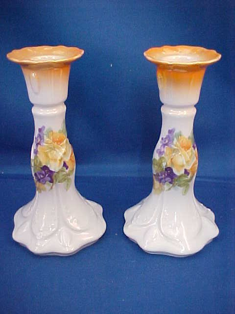 Pair of Victoria china candle holders
