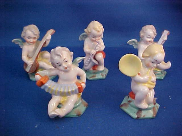 Set of 5 Porcelain cherub band figurines