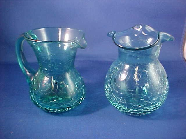 "Lot of 2 blue crackle glass pitcher & vase 4""tall."