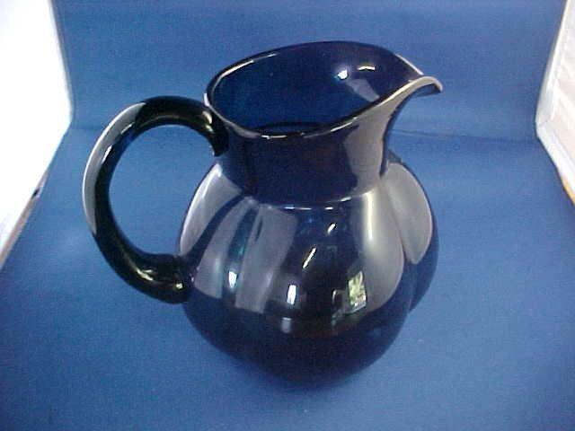 "Dark cobalt blueish green squat style pitcher. 6""tall."