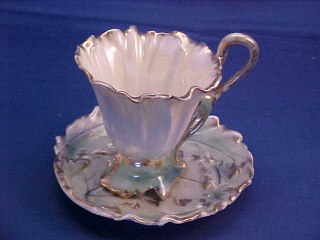 "Royal Bayreuth Green Pansy 4-1/4""w cup and saucer"