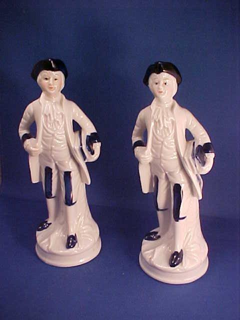 Pair of porcelain colonial figures
