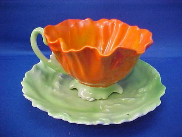 "Royal Bayreuth Red/Orange Pansy 5-1/4""w cup and saucer"