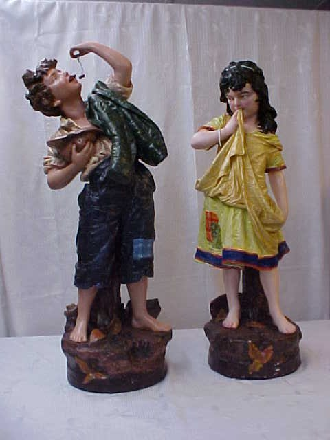 Pair of handpainted statues - boy & girl