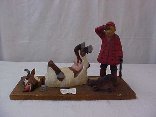 Swedish carved hunter and cow. Folk art