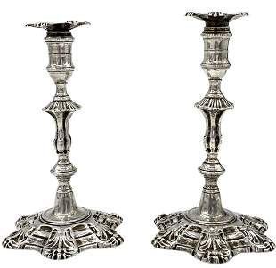 A Pair Of Silver Candlesticks, 18th Century