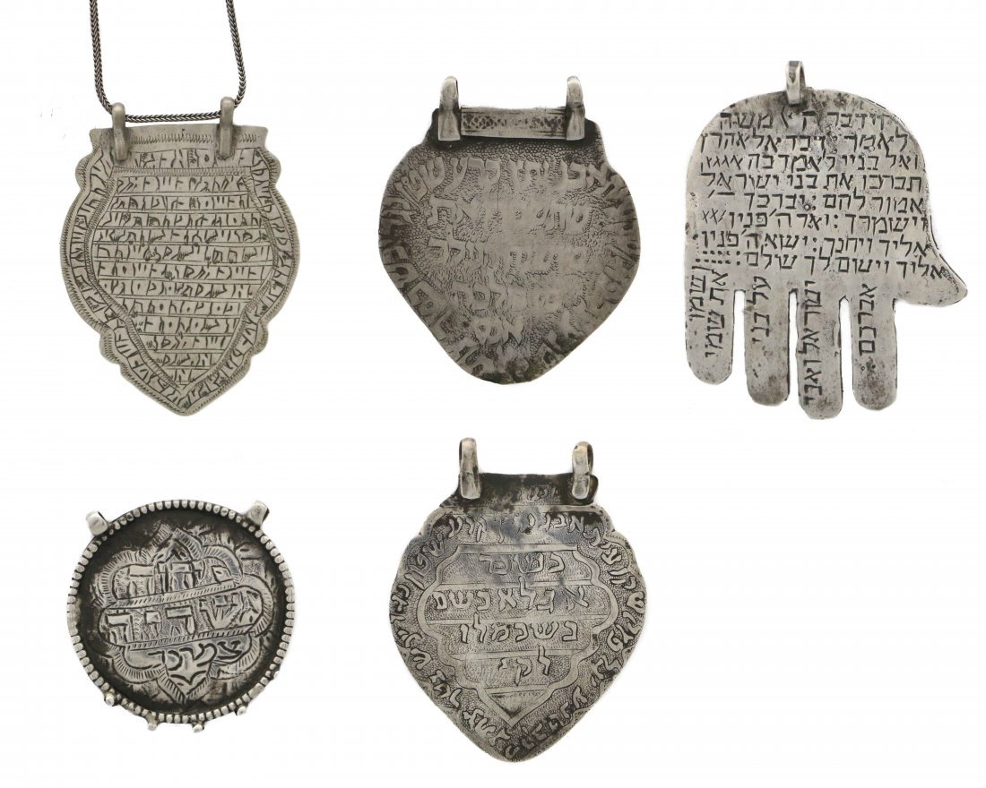 A GROUP OF FIVE AMULETS