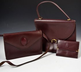 Grouping Two Cartier Vintage Handbags and Wallet