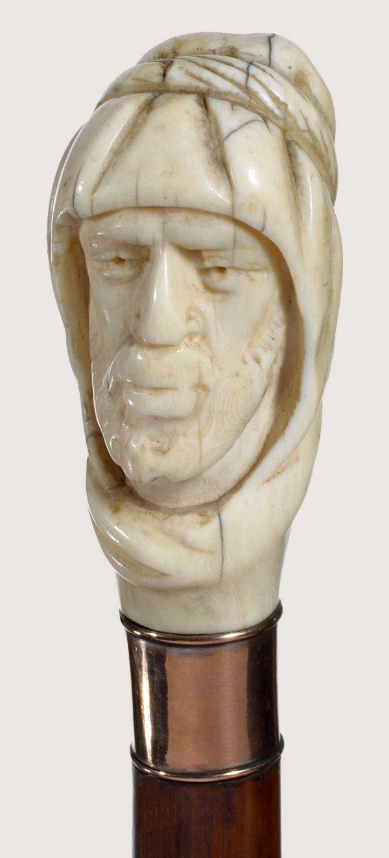 299. Ivory Hooded Man-Circa 1830-Rose gold collar, natu