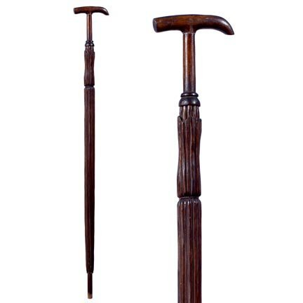 13: Umbrella Folk-C. 1900-Cane carved with details in t