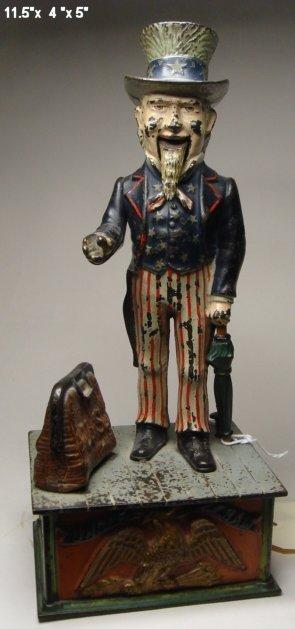 2011: Uncle Sam, mechanical bank, missing trap.