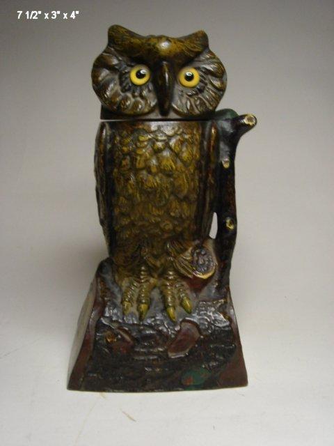2014: Owl Turns Head, mechanical bank, J.E. Stevens Co.