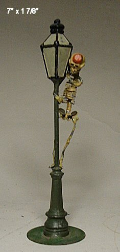 2039: Cast metal street light with skeleton