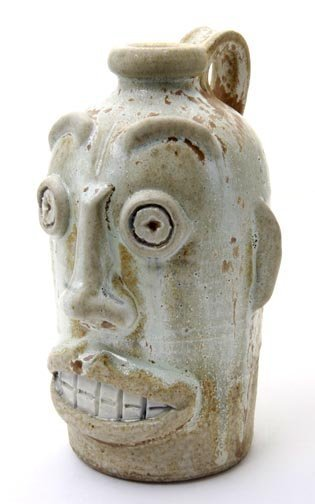 "2: Jeremy Davis, ""Face Jug"".  Glazed and fired pottery."