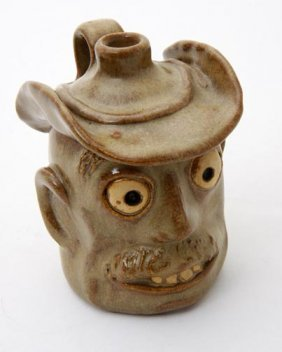 "8: Ron Cooper, ""Slim face jug""  Fired and glazed potter"