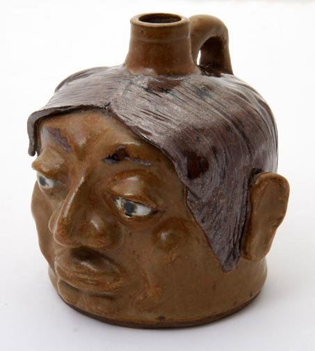 "9: JW Fannin, ""Indian face jug""  Fired and glazed potte"