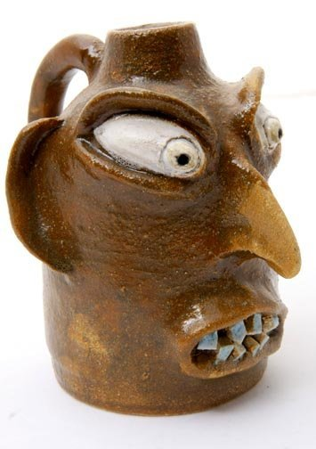 "11: Terrell Pottery, ""face jug""  Fired and glazed potte"