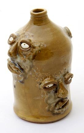 "13: Joel Patton, ""Four face jug"".  Fired and glazed pot"