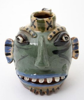 "14: Carl Block, ""face jug"".  Fired and glazed pottery a"