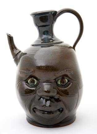 "15: Yvette Lepley, ""Teapot face jug""  Fired and glazed"