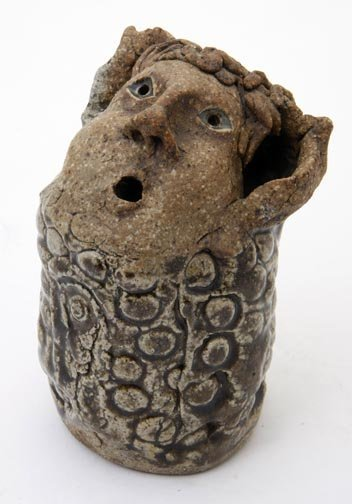 16: Unknown, signed but not legible pottery face jug co