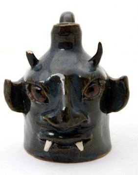 "18: Lin Craven ""Fanged Devil face jug"".  Fired and glaz"