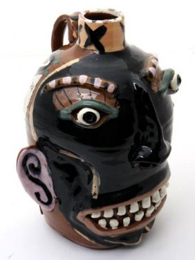 "20: Carl Block, ""face jug"".  Fired and glazed pottery j"