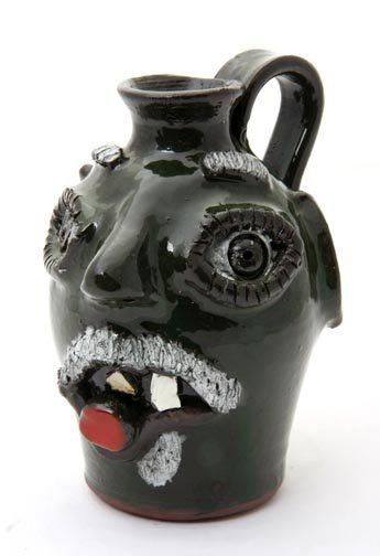 "23: Jamie Ferguson, ""Cigar Smoker""  Fired and glazed po"