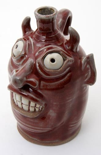 "24: Karen Labarga, ""Red Devil face jug""  Fired and glaz"